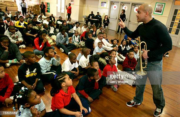 Irvin Mayfield Cultural Ambassador for the city of New Orleans teaches children about Jazz music as part of the New Orleans Jazz OrchestraAllstate...
