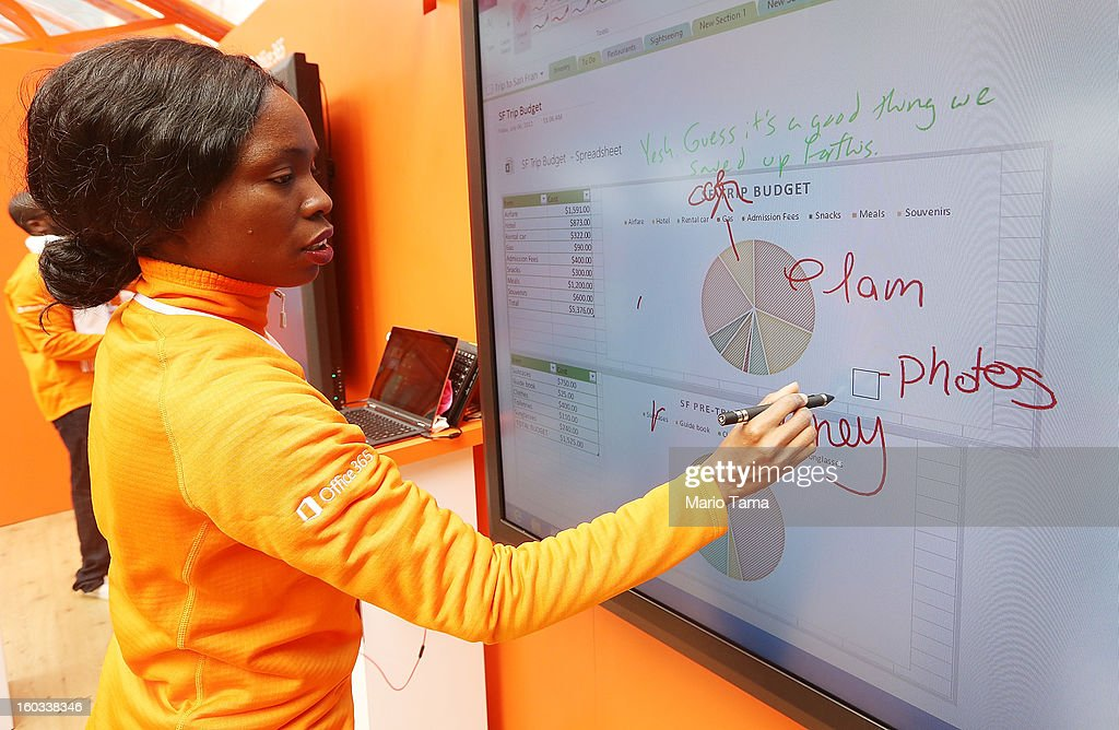 Irvina Moody demonstrates a touchscreen at the Microsoft Office 2013 launch event in Bryant Park on January 29, 2013 in New York City. Microsoft is launching three versions, Office Professional 2013, Office Home & Student 2013 and Office Home & Business 2013.