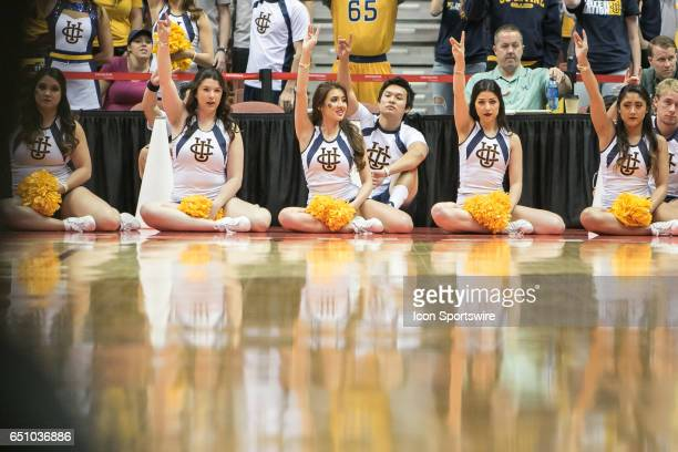 Irvine Cheerleaders hold up the school sign while UC Irvine attempts a freethrow during a Big West Conference Quarterfinals game between UC Irvine...