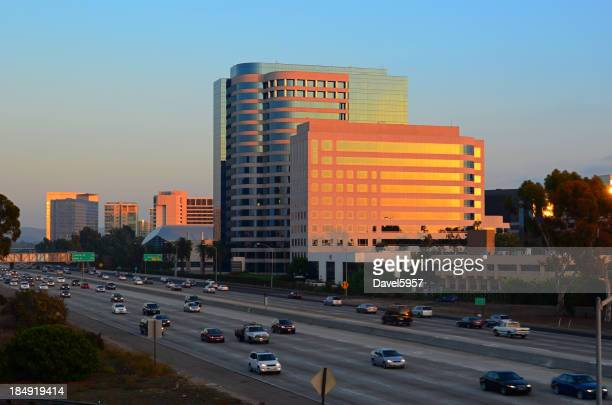 Irvine city skyline and freeway at sunset