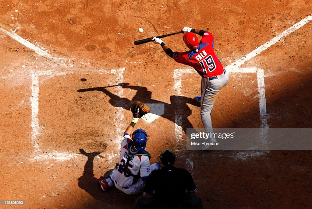 Irving Falu #19 of Puerto Rico bunts during a World Baseball Classic second round game against the Dominican Republicat Marlins Park on March 16, 2013 in Miami, Florida.
