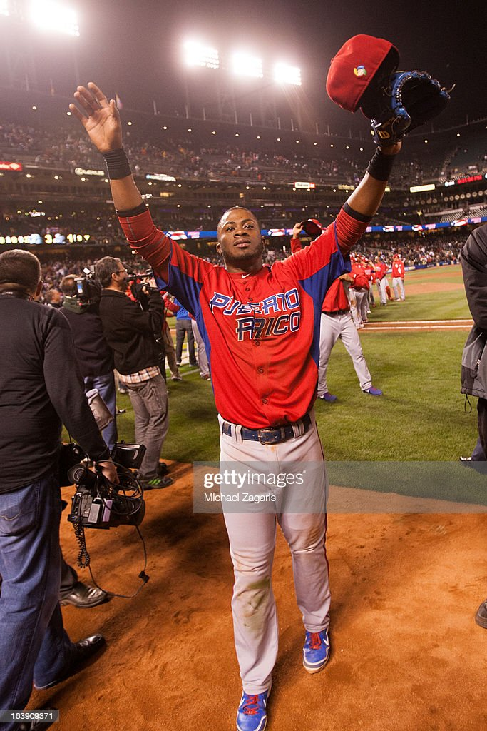 Irving Falu #19 of Team Puerto Rico celebrates after defeating Japan in the semi-final game against Team Japan in the championship round of the 2013 World Baseball Classic on Sunday, March 17, 2013 at AT&T Park in San Francisco, California.