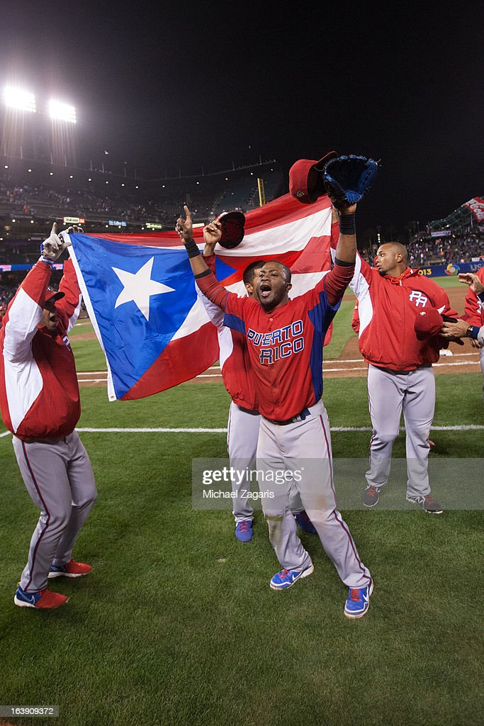 Irving Falu #19 of Team Puerto Rico celebrates with teammates after defeating Japan in the semi-final game against Team Japan in the championship round of the 2013 World Baseball Classic on Sunday, March 17, 2013 at AT&T Park in San Francisco, California.
