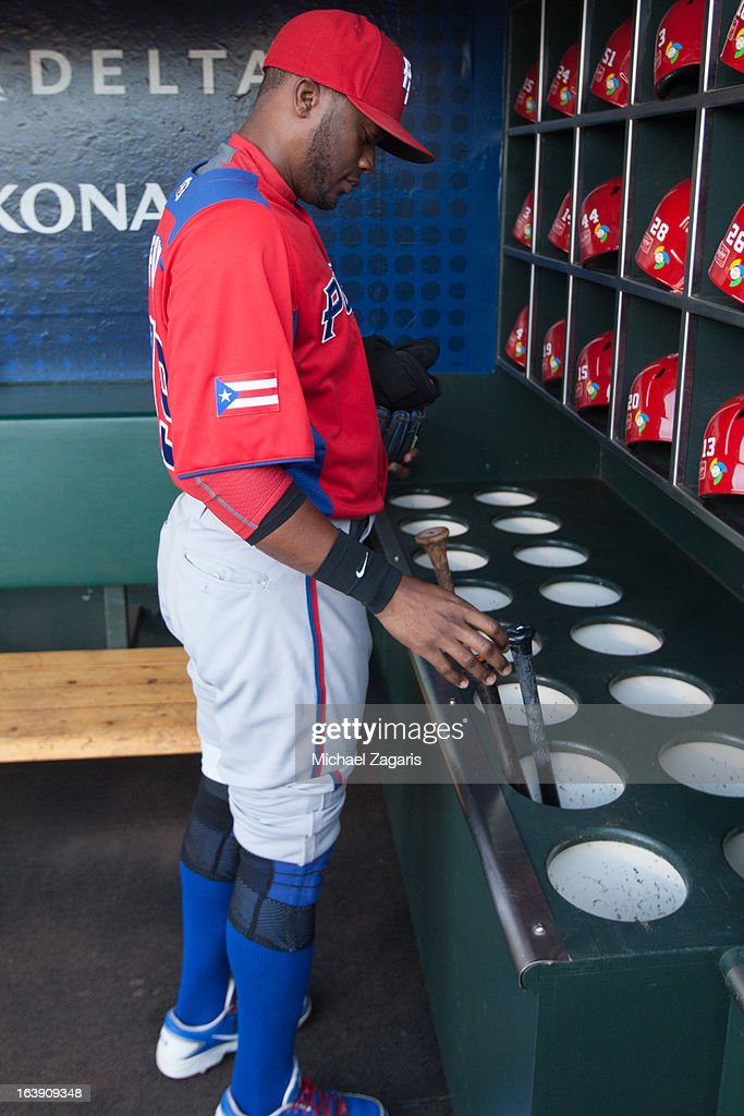 Irving Falu #19 of Team Puerto Rico is seen by the bat rack in the dugout before the semi-final game against Team Japan in the championship round of the 2013 World Baseball Classic on Sunday, March 17, 2013 at AT&T Park in San Francisco, California.