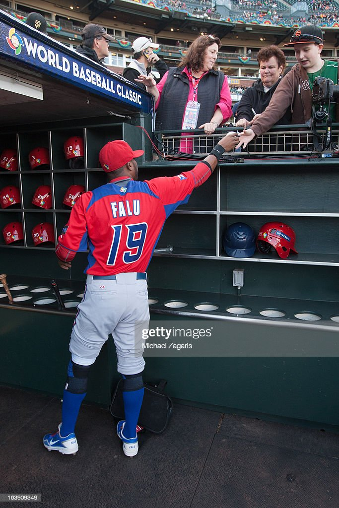 Irving Falu #19 of Team Puerto Rico signs autographs before the semi-final game against Team Japan in the championship round of the 2013 World Baseball Classic on Sunday, March 17, 2013 at AT&T Park in San Francisco, California.