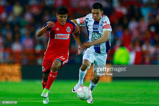 Irving Lozano of Pachuca fights for the ball with Jesus Sanchez of Chivas during the 15th round match between Pachuca and Chivas as part of the...