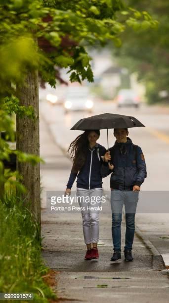 Iryna Kuchinko and Vitalii Vizhbovskyi walk arm and arm beneath an umbrella down Temple Avenue in Old Orchard on Monday June 5 2017 Having just...
