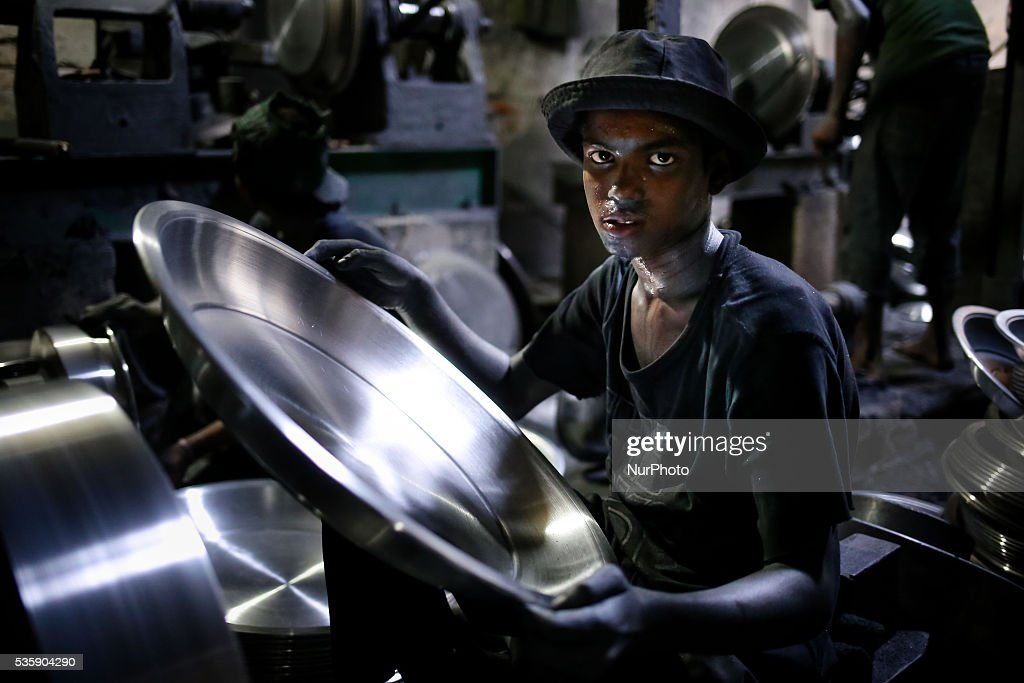 IMRAN is a 13 years old boy from Patuakhali district who works in auminium factory. He earns BDT. 1100 (Approximately 14 USD), in Dhaka, Bangladesh, on May 30, 2016. Aluminum Factory is very common in Bangladesh where different kinds of pot and jar made from aluminum. Such industry creates a sound source of employment. Among these workers many of them are children aged less than 15 years. There is no statistics available to determine exact ratio of adults and children; but it seems around 30-50% workers are children. The reason of high child labor ratio is cheap labor. According to child labor law of Bangladesh it is prohibited in serious working condition but there is no implication. The current economic condition of Bangladesh is unable to solve child labor problem. It's not possible to banned child labor completely at any time. The thing is these children's families are in need. They don't have any other options other than work for money and help their family. If government really going to banned child labor in the country, the situation would be worse than this. Their living of standards even go down more. So before banning child labor, government needs to develop economic condition of their family first.