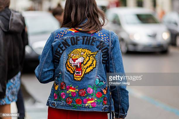 is A denim jacket with tiger print seen outside Wunderkind during Milan Fashion Week Spring/Summer 2017 on September 21 2016 in Milan Italy