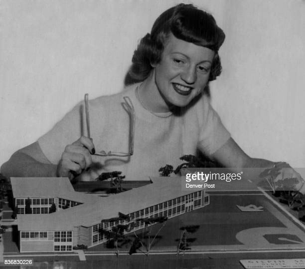 DEC 25 1949 ***** is a model shown by Mrs Norene Link of the school administration staff of the sleek new Gilpin school to be built on the same site...