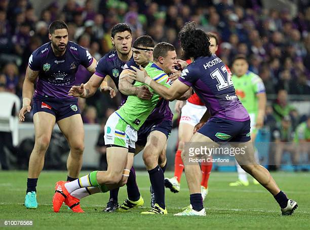 is challenged by is challenged by Tohu Harris of the Storm during the NRL Preliminary Final match between the Melbourne Storm and the Canberra...