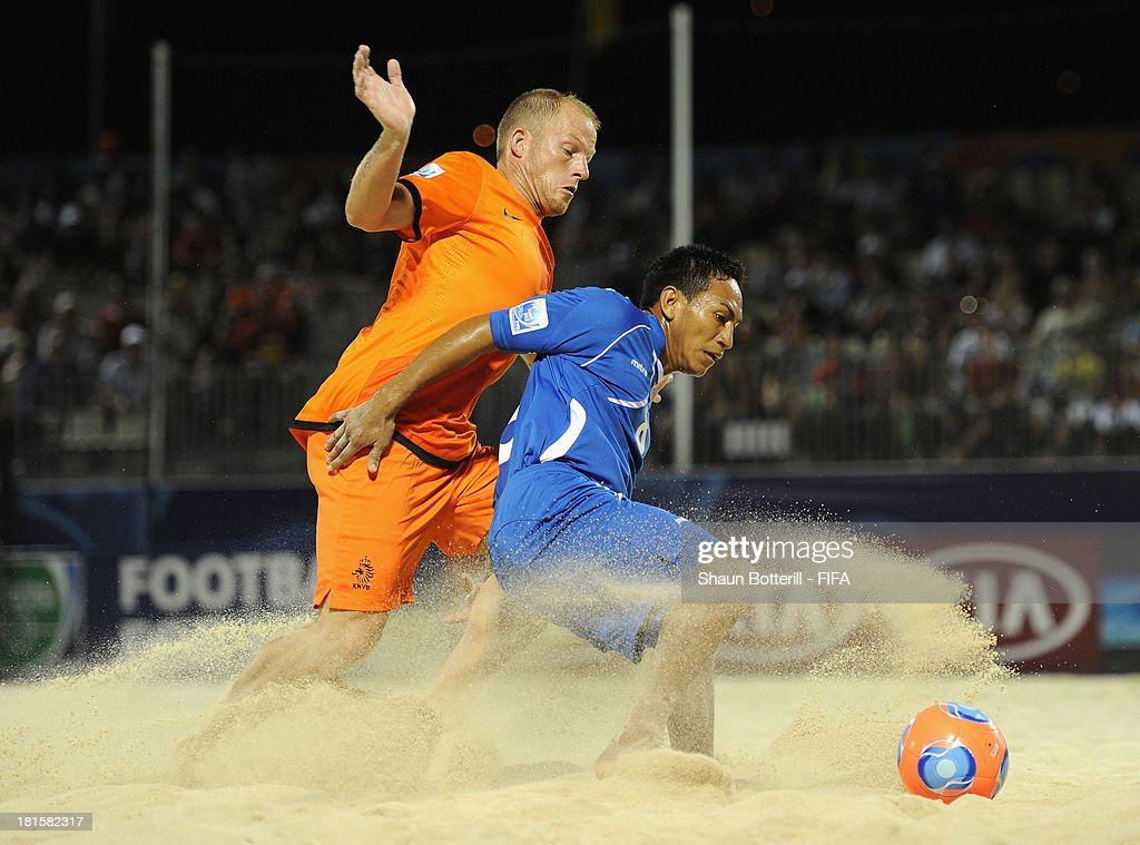 is Elmer Robles of El Salvador is challenged by Patrick Ax of Netherlands during the FIFA Beach Soccer World Cup Tahiti 2013 Group B match between El Salvador and Netherlands at the Tahua To'ata stadium on September 21, 2013 in Papeete, French Polynesia.