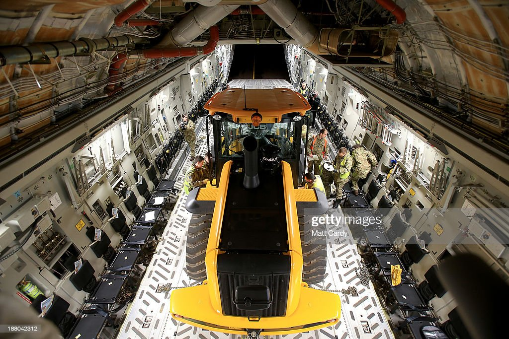 A JCB is loaded onto a C-17 aircraft operated by No 99 Squadron at RAF Brize Norton on November 15, 2013 in Brize Norton, England. The flight departed RAF Brize Norton this morning to provide humanitarian support to the Philippines transporting a variety of key vehicles and equipment along with medical supplies.