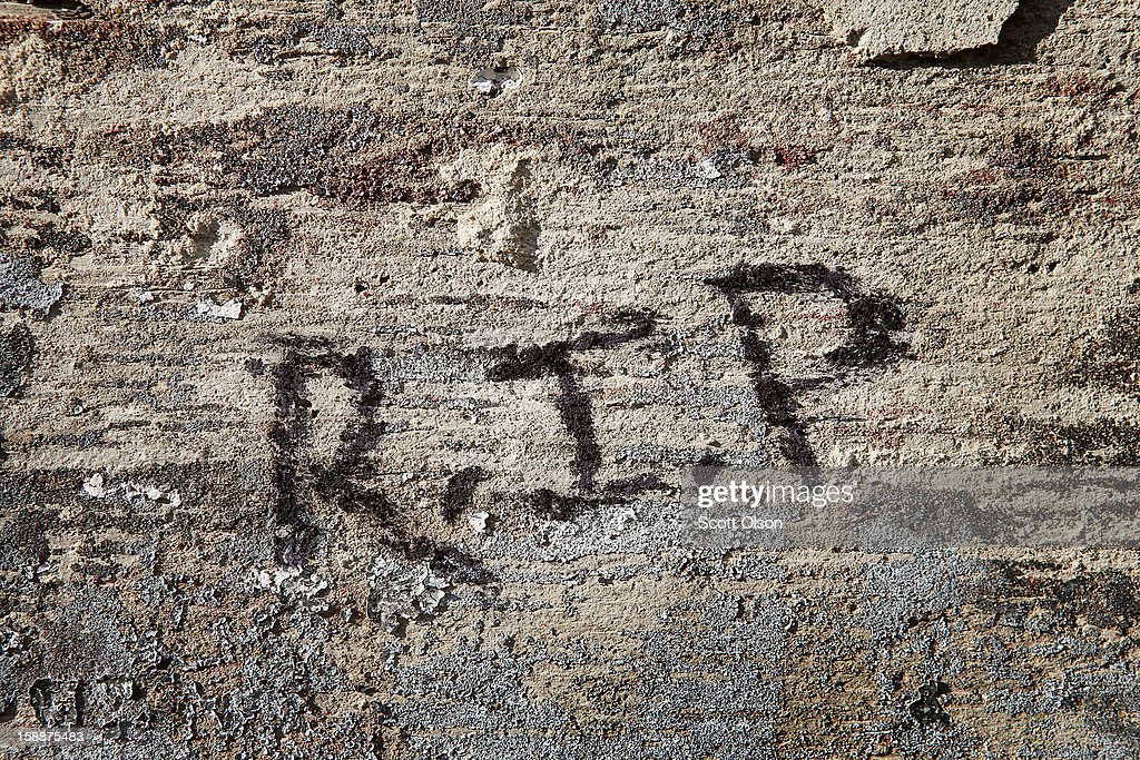 R. I. P. (Rest In Peace) is scrawled on a wall in the alley near the spot where 20-year-old Octavius Dontrell Lamb was shot yesterday and killed, on January 2, 2013 in Chicago, Illinois. Lamb was the first murder victim of 2013 in Chicago, a city which saw at least 506 murders in 2012. Fifteen people were shot in Chicago on the first day of the year, three fatally.