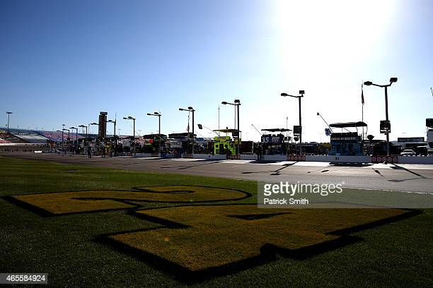 A '24' is seen on the infield grass in support of Jeff Gordon driver of the 3M Chevrolet ahead of the NASCAR Sprint Cup Series Kobalt 400 at Las...