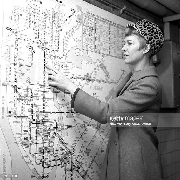 Is She on the Right Track Nancy Baker appears perplexed while studying subway map of new routes going into effect today on BMT and IND systems But...