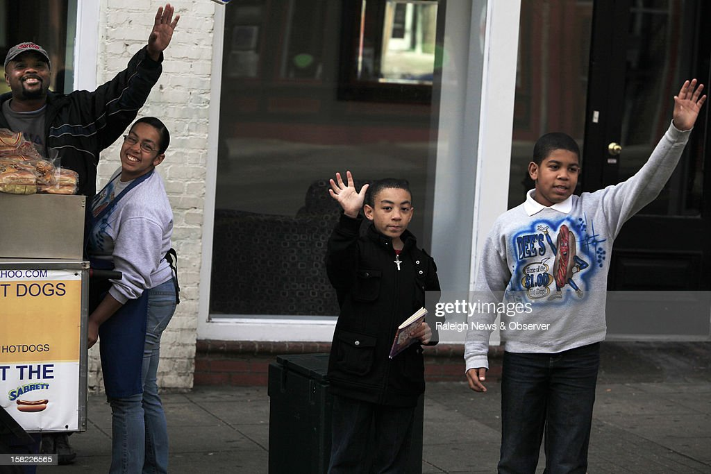 'Is that my birthday present,' Dawrence Hutley, 11, right, yelled after he and his brother Donte, 9, see a 23-foot banana-shaped car in Raleigh, North Carolina, on Tuesday, December 11, 2012. Their mother, Aireal Irizarry, is second from left. Steve Braithwaite cruises through Raleigh, North Carolina, on a quest to circle the globe with his Big Banana Car. For more information, visit www.bigbananacar.com.