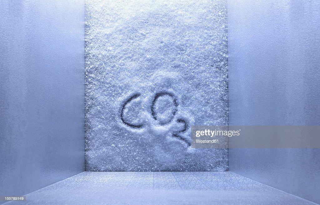 CO2 is written on ice in freezer : Stock Photo