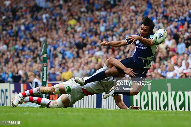 Isa Nacewa of Leinster is tackled by Stephen Ferris of Ulster during the Heineken Cup Final between Leinster and Ulster at Twickenham Stadium on May...