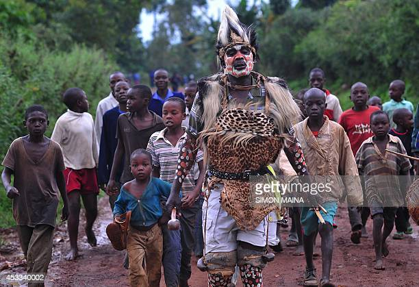 Isaac Arema Shiboya a traditional circumciser is followed by boys as he prepares to perform an operation in Shinyalu in Kakamega on August 8 2014...