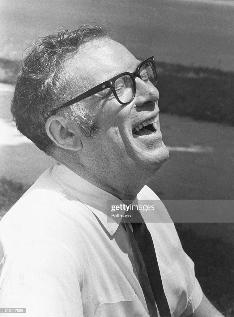 Isaac Asimov is on the beach having a good laugh
