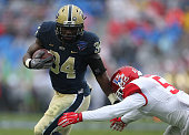 Isaac Bennett of the Pittsburgh Panthers runs for a touchdown during the Lockheed Martin Armed Forces Bowl game against the Houston Cougars at Amon G...
