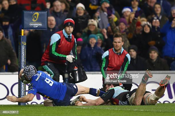 Isaac Boss of Leinster scores his sides first try despite the challenge from Jack Clifford of Harlequins during the European Rugby Champions Cup Pool...