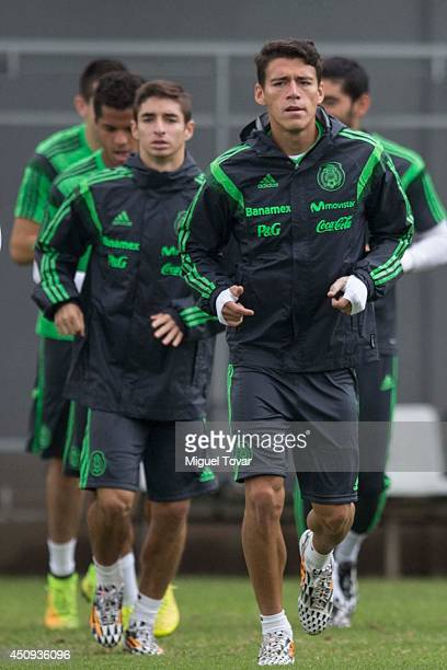 Isaac Brizuela and Hector Moreno warm up during a training session of Mexico at Rei Pele Training Center on June 20 2014 in Santos Brazil Mexico will...