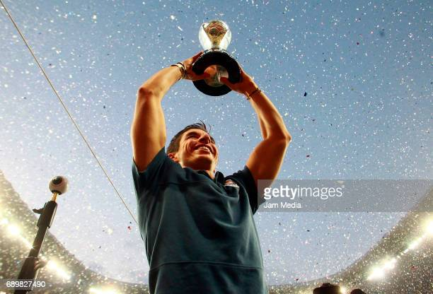 Isaac Brizuela of Chivas celebrates with the champions trophy after the Final second leg match between Chivas and Tigres UANL as part of the Torneo...