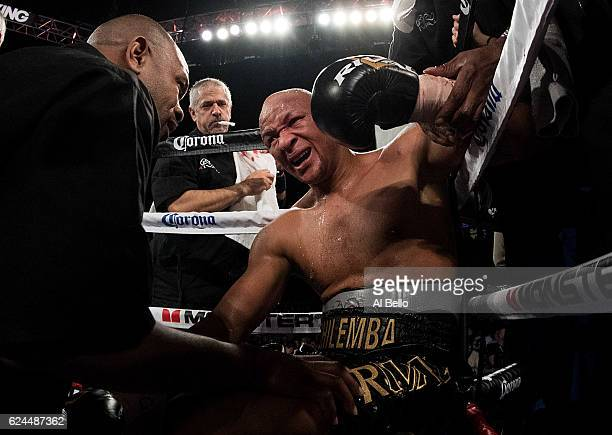 Isaac Chilemba of Malawi grimaces in pain in his corner as his light heavyweight bout against Oleksandr Gvozdyk is stopped due to injury at TMobile...