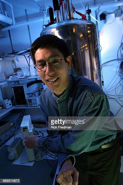 Isaac Chuang Associate Professor of Media Arts and Sciences at the Media Lab at MIT Chuang is pictured in front of the Quantum Computer holding a...