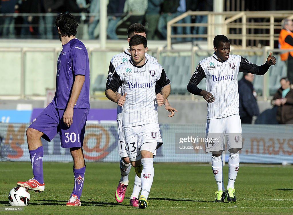 Isaac Cofie of AC Chievo Verona (R) celebrates with his team-mates after scoring the opening goal during the Serie A match between ACF Fiorentina and AC Chievo Verona at Stadio Artemio Franchi on March 3, 2013 in Florence, Italy.