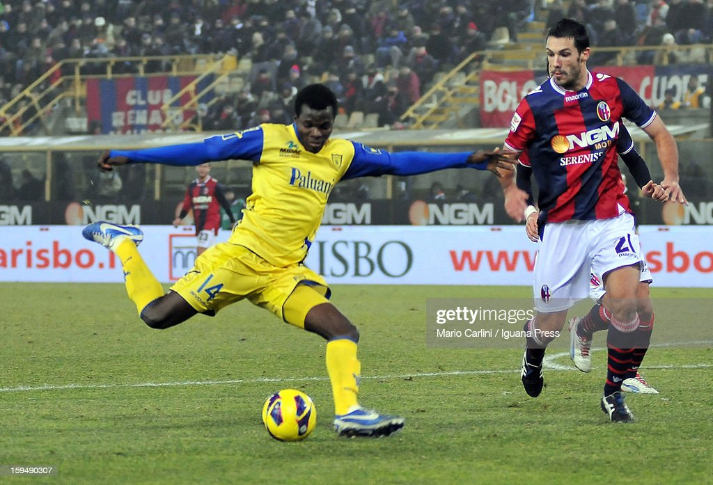 Isaac Cofie (L) of AC Chievo Verona shoots towards goal as Niccolo Cherubin of Bologna FC makes a challenge during the Serie A match between Bologna FC and AC Chievo Verona at Stadio Renato Dall'Ara on January 12, 2013 in Bologna, Italy.