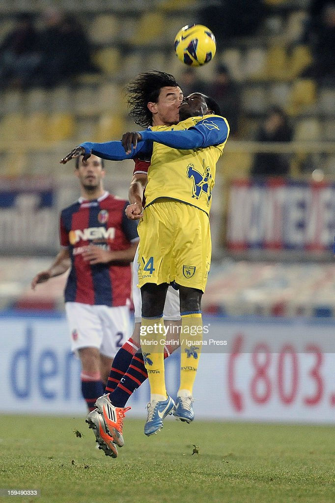 Isaac Cofie (R) of AC Chievo Verona wins a header with Rene Khrin of Bologna FC during the Serie A match between Bologna FC and AC Chievo Verona at Stadio Renato Dall'Ara on January 12, 2013 in Bologna, Italy.
