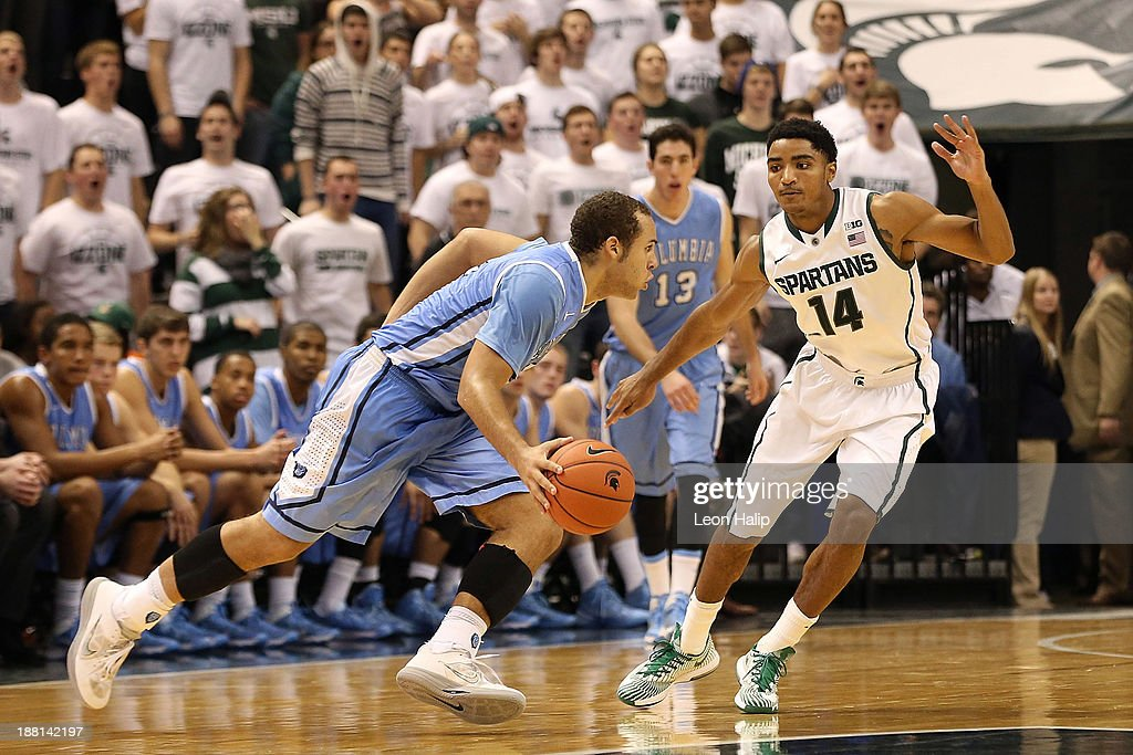 Isaac Cohen #2 of the Columbia Lions drives the ball to the basket as Gary Harris #14 of the Michigan State Spartans defends during the second half of the game at Breslin Center on November 15, 2013 in East Lansing, Michigan. Michigan State defeated Columbia 62-53.