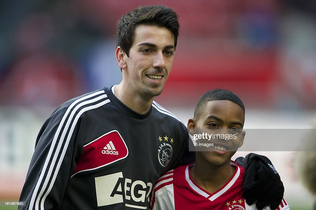 Isaac Cuenca of Ajax, mascot of Ajax during the Dutch Eredivisie match between Ajax Amsterdam and Roda JC Kerkrade at the Amsterdam Arena on february 10, 2013 in Amsterdam, The Netherlands