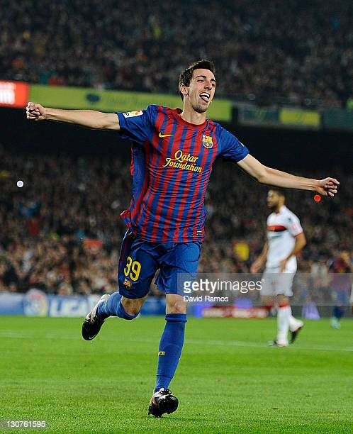 Isaac Cuenca of FC Barcelona celebrates after scoring his fourth team's goal during the La Lliga match between FC Barcelona and RCD mallorca at Camp...