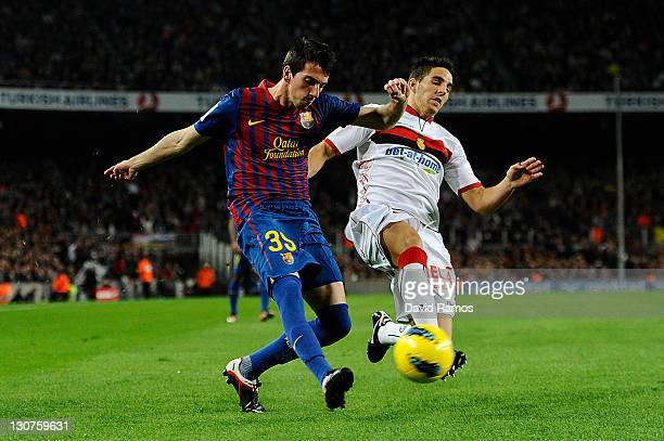 Isaac Cuenca of FC Barcelona challenges for the ball with Pedro Bigas of RCD mallorca during the La Lliga match between FC Barcelona and RCD mallorca...