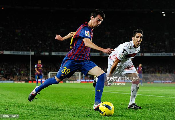 Isaac Cuenca of FC Barcelona duels for the ball with Pedro Bigas of RCD mallorca during the La Lliga match between FC Barcelona and RCD mallorca at...