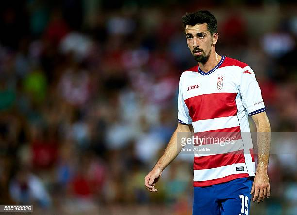 Isaac Cuenca of Granada FC looks on during a friendly match between Granada FC and Sevilla FC at Estadio Nuevo los Carmenes on August 2 2016 in...