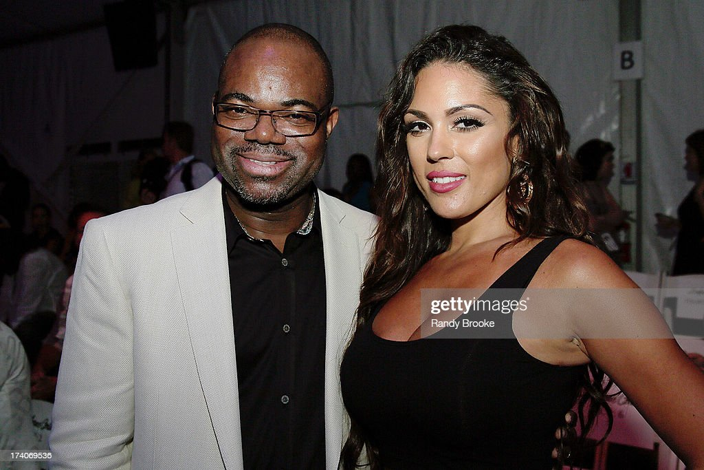 Isaac Daniel, Founder of Reel Code, with International Maxim Model Carissa Rosario at the Mercedes-Benz Fashion Week Swim 2014 before the Dolores Cortes show at Raleigh Hotel on July 19, 2013 in Miami Beach, Florida.