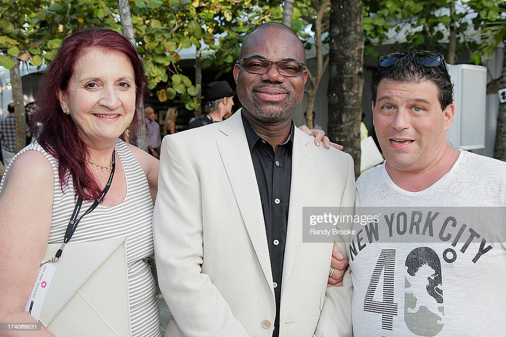 Isaac Daniel of Reel Code Media with Bonnie Bien, owner of La Presse PR, and Richard Spiegel, Editorial Director for The Fashion Tribune at Mercedes-Benz Fashion Week Swim 2014 at Raleigh Hotel on July 19, 2013 in Miami Beach, Florida.