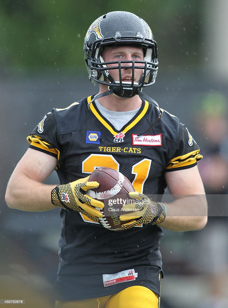 Isaac Dell of the Hamilton TigerCats warms up prior to play against the Calgary Stampeders in a CFL game at Ron Joyce Stadium on August 16 2014 in...