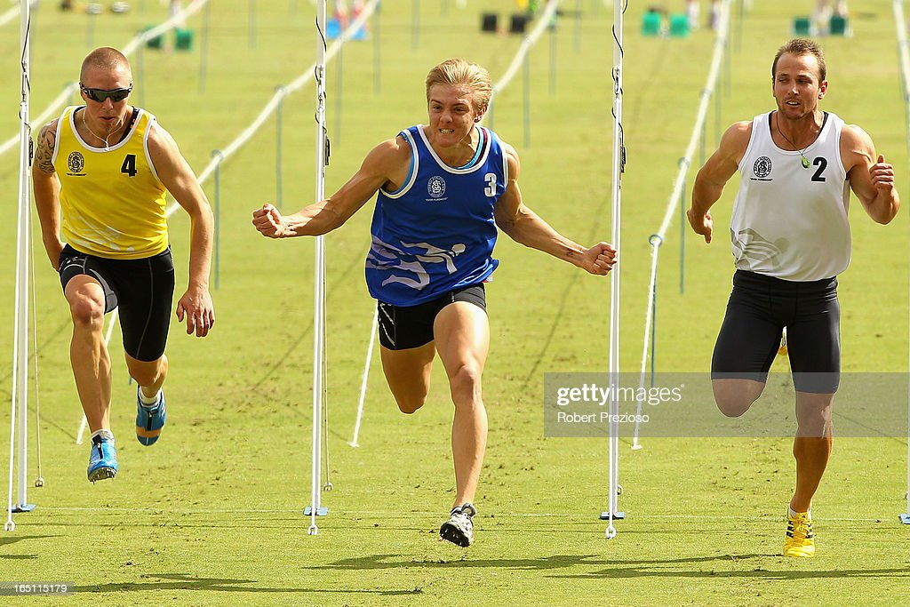 Isaac Dunmall (M) of Queensland celebrates winning in the Gift Hotel Arthur Postle Handicap 70m Final during the 2013 Stawell Gift carnival at Central Park on March 31, 2013 in Stawell, Australia.