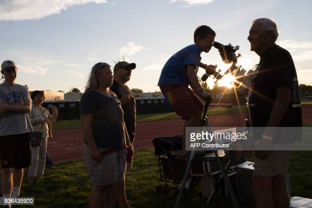 Isaac Ehrenburg looks through a telescope at the setting sun Sunday August 20 2017 during preeclipse activities at Madras High School in Madras...