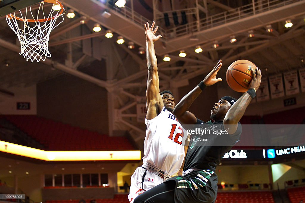 Isaac Fleming of the Hawaii Warriors goes to the basket during the first half against Keenan Evans of the Texas Tech Red Raiders on November 28 2015...