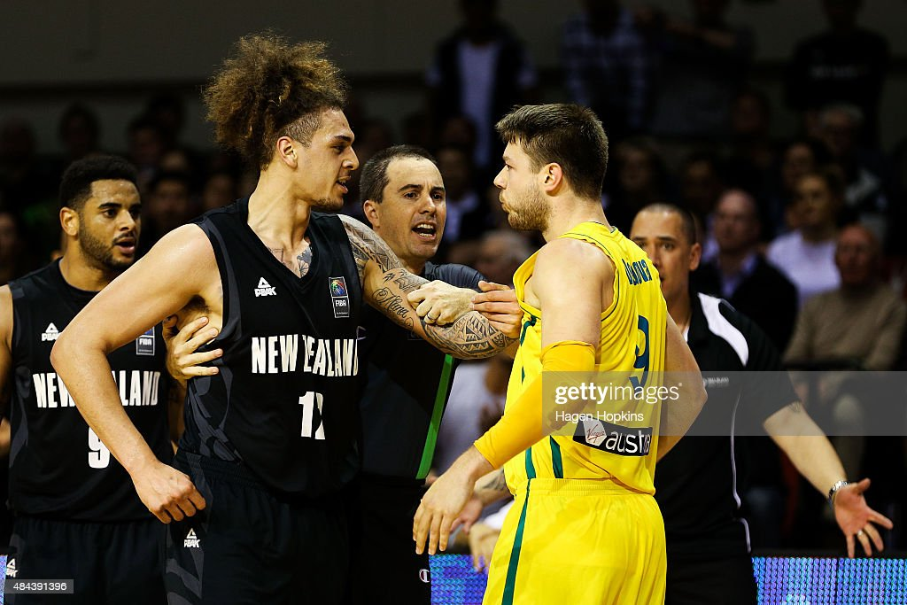 Isaac Fotu of the Tall Blacks exchanges words with Matthew Dellavedova of the Boomers during the game two match between the New Zealand Tall Blacks and Australian Boomers at at TSB Bank Arena on August 18, 2015 in Wellington, New Zealand.