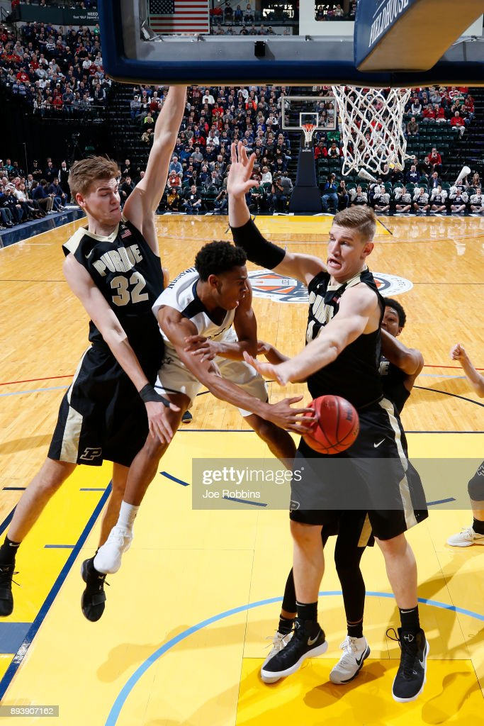 Isaac Haas #44 and Matt Haarms #32 of the Purdue Boilermakers defend against Aaron Thompson #2 of the Butler Bulldogs in the first half of the Crossroads Classic at Bankers Life Fieldhouse on December 16, 2017 in Indianapolis, Indiana. Purdue won 82-67.