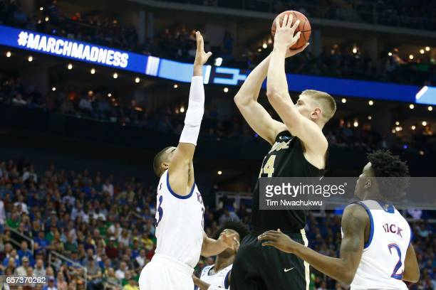 Isaac Haas of the Purdue Boilermakers attempts a jump shot over Landen Lucas of the Kansas Jayhawks the 2017 NCAA Men's Basketball Tournament held at...