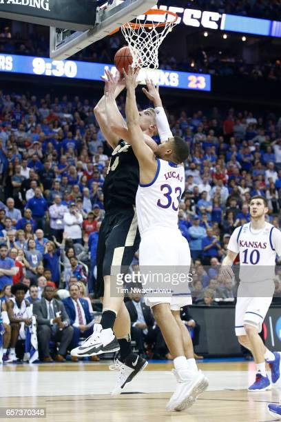 Isaac Haas of the Purdue Boilermakers attempts a layup contested by Landen Lucas of the Kansas Jayhawks during the 2017 NCAA Men's Basketball...